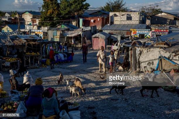 Vendors sell food and merchandise at the Caradeux refugee camp set up after the 2010 earthquake in PortAuPrince Haiti on Monday Jan 29 2018 Billions...