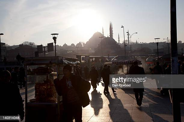 Vendors sell food beside Galata Bridge on February 23 2012 in Istanbul Turkey Though not the capital Istanbul is the cultural economic and financial...