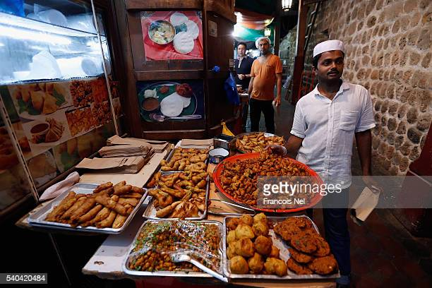 Vendors sell food during the holy month of Ramadan on June 15 2016 in Dubai United Arab Emirates Muslim men and women across the world observe...