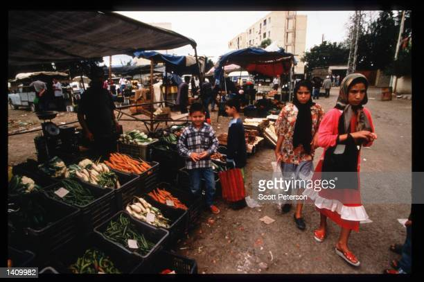 Vendors sell food October 22 1997 in Sidi Musa Algeria Angered by the suppression of the Islamic Salvation Front when elections were suspended in...