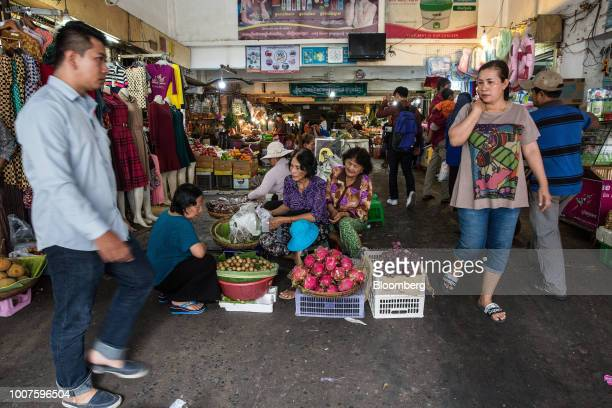 Vendors sell fruits at a stall at Orussey Market in Phnom Penh Cambodia on Friday July 27 2018 Cambodian Prime MinisterHun Senextended his...