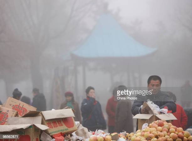 Vendors sell goods at a market in fog on April 20 2010 in Changchun of Jilin Province China A heavy fog hit Jilin Province since April 19 with...