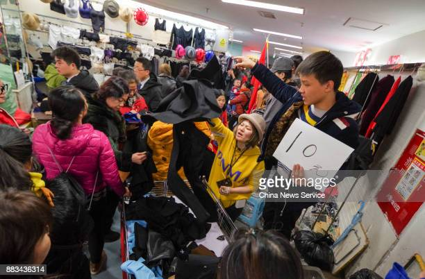 Vendors sell merchandise at the Dongding wholesale market before its closing on November 30 2017 in Beijing China The Dongding market the last of 12...