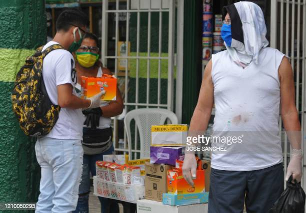 Vendors sell products including gloves and vitamins to fight the novel coronavirus COVID19 in downtown Guayaquil Ecuador on April 15 2020 Guayaquil...