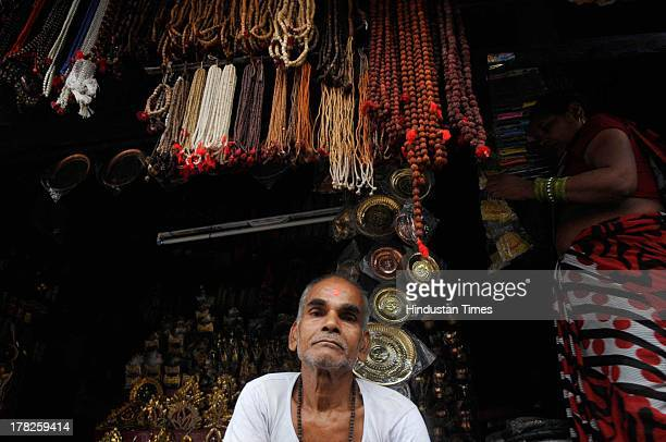 Vendors sell religious items at a market on August 27, 2013 in Ayodhya, India. Two days after the failed Parikarma attempt by Vishwa Hindu Parishad ,...