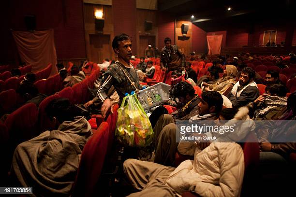 Vendors sell snacks in Ariana Cinema December 1 2010 in Kabul Afghanistan Going to the movies once banned under the Taliban has become a popular form...