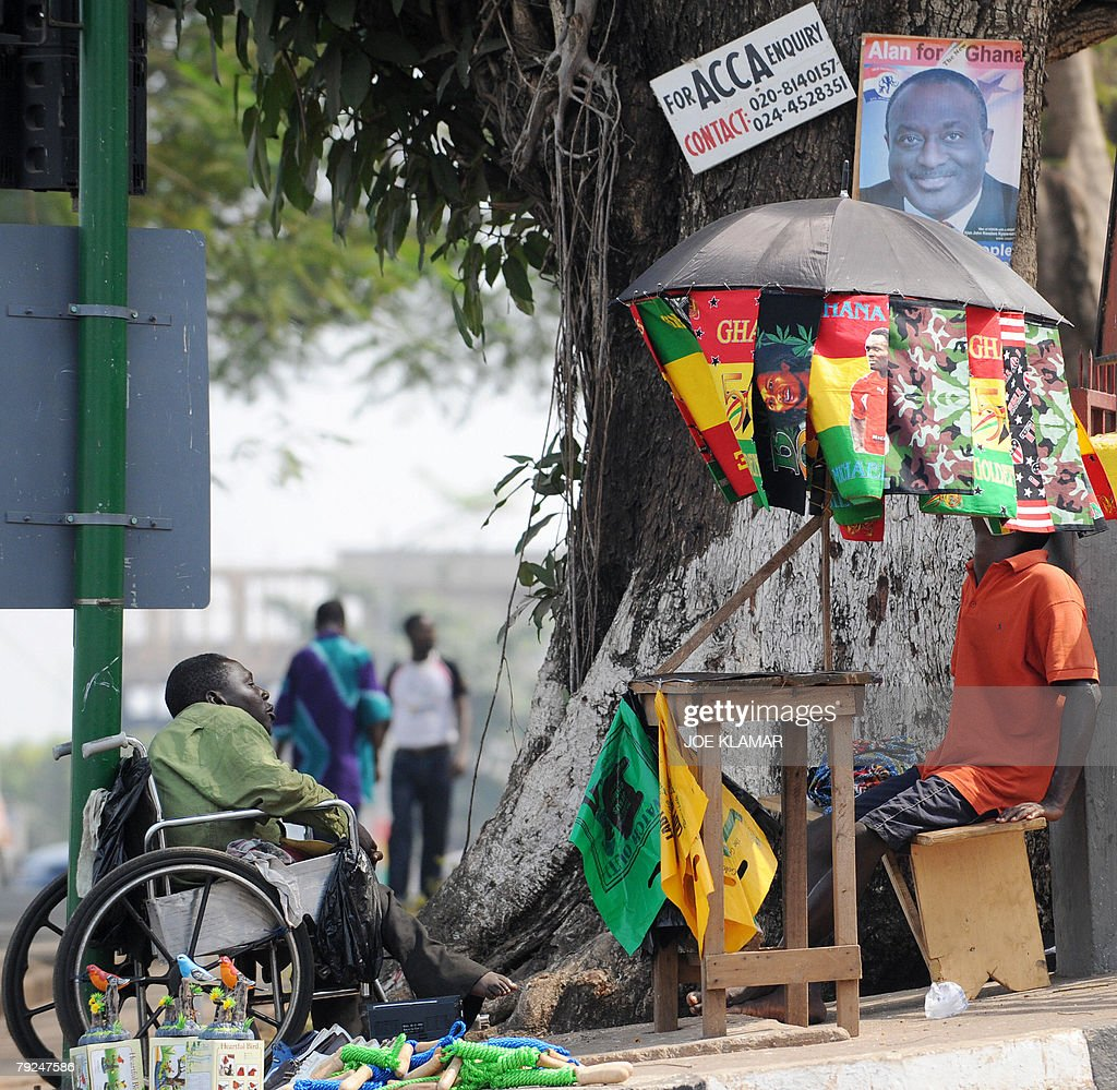 Vendors sell souvenirs and CAN2008 flags in the city center of Kumasi 25 January, 2008,during the African Cup of Nations football championship.