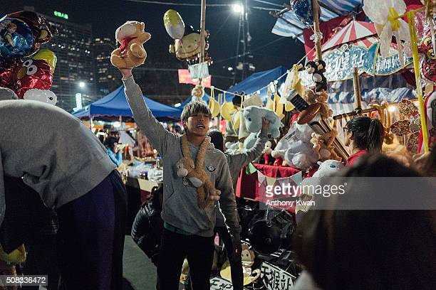 Vendors sell stuffed monkey dolls at the Chinese New Year fair on February 4 2016 in Hong Kong The Chinese Lunar New Year also known as the Spring...