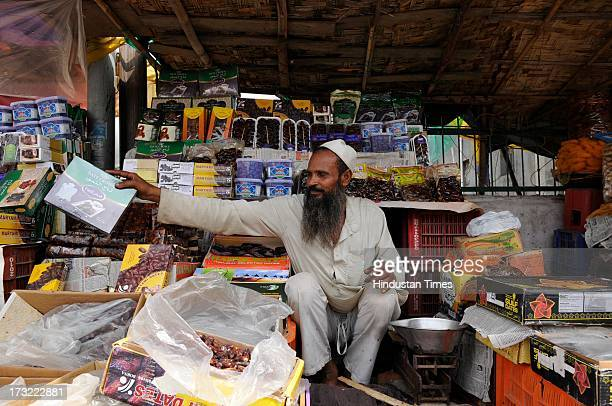 Vendors sell the dates outside a mosque on July 10, 2013 in Noida, India. The first day of Ramadan is likely to be observed from July 11 in many...