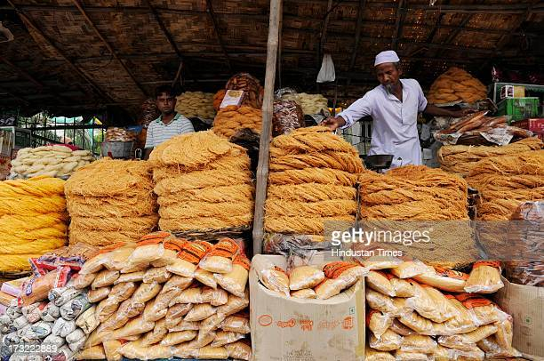 Vendors sell the Seviyan outside a mosque on July 10, 2013 in Noida, India. The first day of Ramadan is likely to be observed from July 11 in many...