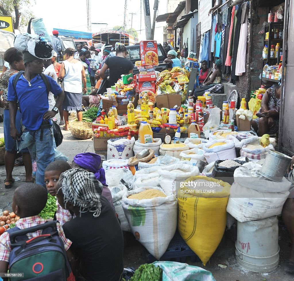 Vendors sell their products November 20, 2012 in a market place in Petion-Ville, Haiti. Food prices and the cost of living has skyrocketed in the wake of Hurricane Sandy, the deadly storm that tore through the Caribbean long before reaching America. Farmers in southwest Haiti, already struggling, said they had 'lost everything' after the tropical storms that have hit the island this year. 'I am ruined. I lost everything. I invested more than 50,000 gourdes (about 2,000 dollars),' said Dieunord Elismé, a farmer of 27 years, who also lost his home. 'Now, we must all over again.' As Dieunord, many small farmers have seen their investment disappear.'We've been hit twice,' he recalls. And when Hurricane Sandy late October, high winds and floods destroyed vegetable crops that were on the eve of the harvest. Livestock, plantations and houses were swept away, melting all the savings of farmers. The industry has lost a total of $ 104 million. Haiti, which produced approximately 50% of its food needs, will fall below 40% because of bad weather, also warn agricultural experts. AFP PHOTO / Thony BELIZAIRE