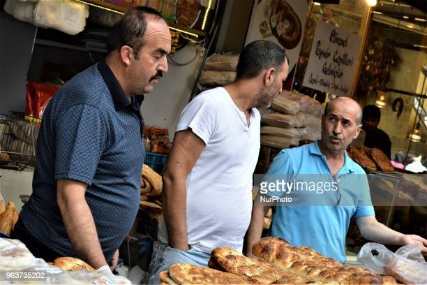 Vendors sell traditional Ramadan bread in a bazaar during the Muslim holy fasting month of Ramadan in the historic Ulus district of Ankara Turkey on...