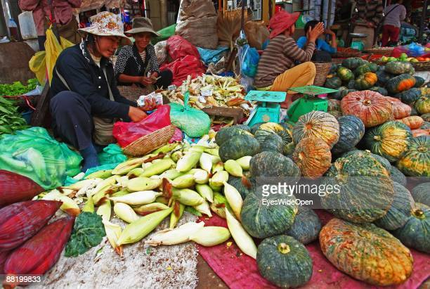 Vendors selling pumpkin corn and banana leaves on a marketplace in Siem Reap Cambodia Where Tourists take part in a cooking course to learn how to...