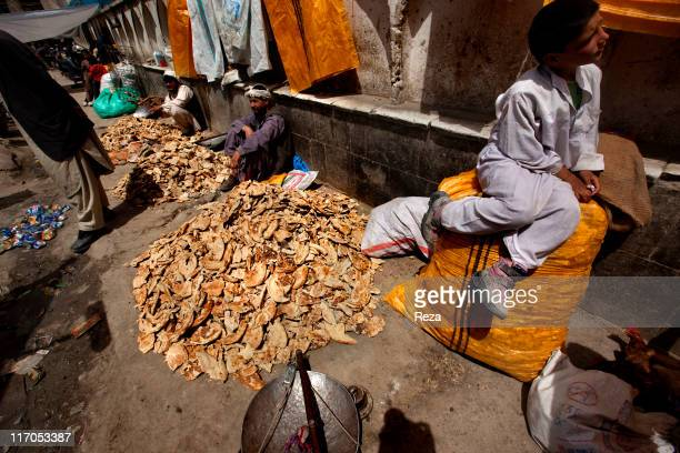Vendors selling stale bread used by farmers to feed the livestock May 7 2009 in Kabul's Central Market Afghanistan