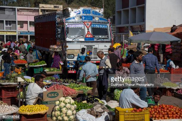 Vendors selling vegetable and fruits in a crowded wholesale market