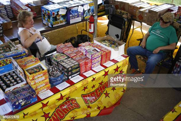 Vendors sit at a roadside fireworks tent in Catlettsburg Kentucky US on Thursday June 28 2018 According to the American Pyrotechnics Association the...