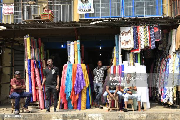 Vendors sit in stalls in Lagos Nigeria on Saturday Feb 16 2019 A lastminute delay of Nigerias general elections by a week has thrown Africas biggest...