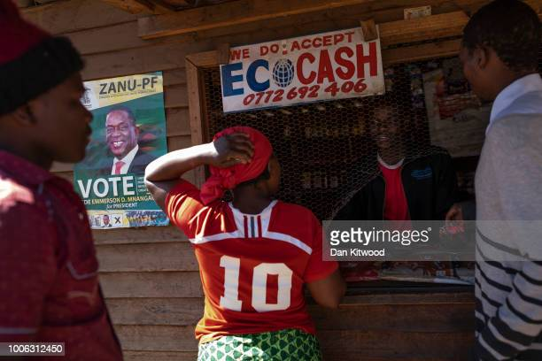 Vendors use a street shack that accepts EcoCash' to buy goods in the Mbare neighborhood on July 27, 2018 in Harare, Zimbabwe. EcoCash is an...