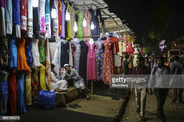 Vendors wait for customers at a clothing stall in Mumbai India on Friday Dec 15 2017 India's inflation surged past the central bank's target...