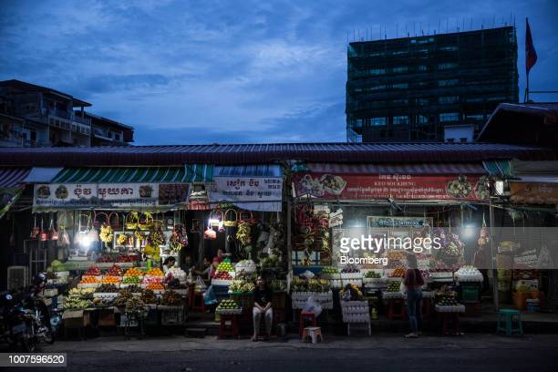 Vendors wait for customers at fruit stalls at night in Phnom Penh Cambodia on Sunday July 29 2018 Cambodian Prime MinisterHun Senextended his...