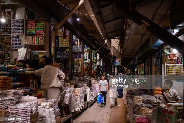 Vendors wait for customers at Mandai Bazaar in Kabul Afghanistan on Thursday July 12 2018 US President Donald last year said 16000 US troops would...