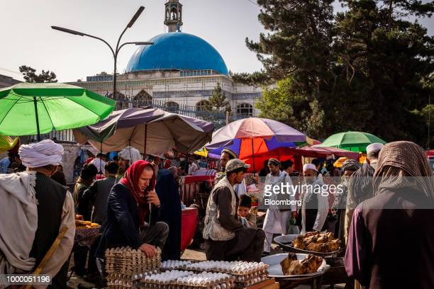 Vendors wait for customers at stalls in a street market near Pule Khishti Mosque in Kabul Afghanistan on Thursday July 12 2018 US President Donald...