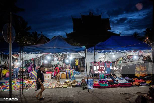 Vendors wait for tourists at the Night Market in Luang Prabang Laos on Sunday Oct 21 2018 Laos's economy is set to expand at 7 percent this year...