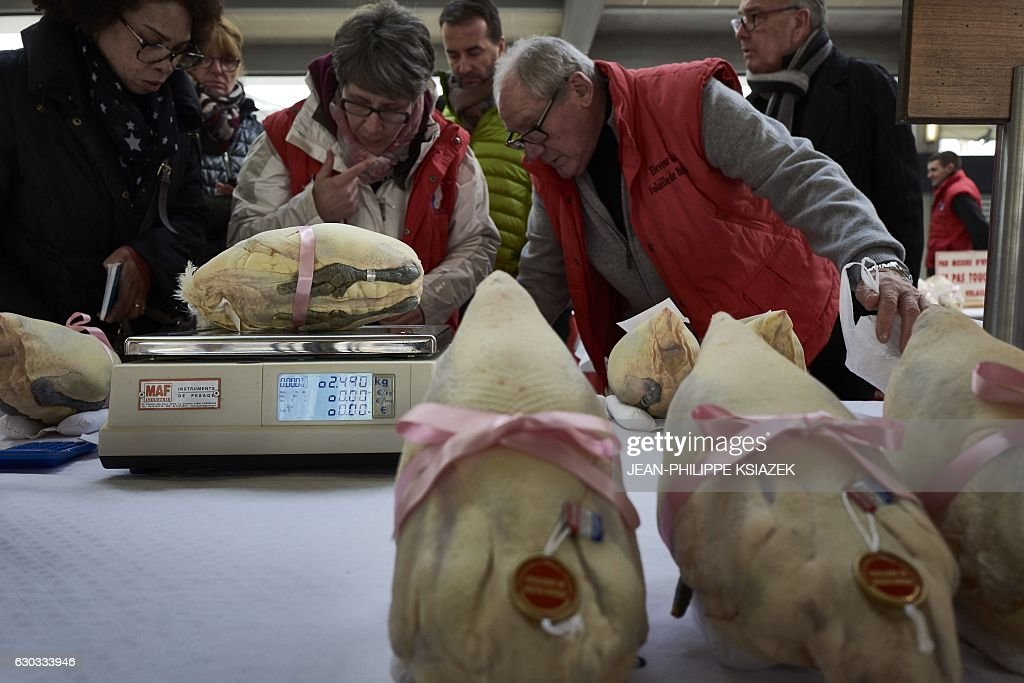 Vendors Weigh Poultry As People Look At Fattened Chickens Capons