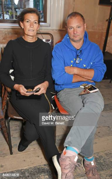 Venetia Scott and Juergen Teller wearing Burberry at the Burberry September 2017 at London Fashion Week at The Old Sessions House on September 16...