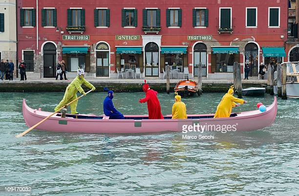 A venetian boat sails along one of the Murano canals with a crew of men dressed as Teletubbies on February 27 2011 in Venice Italy The Venice...