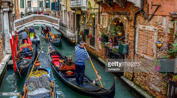 a venetian canal by the trattoria sempione, venice italy - venice italy stock pictures, royalty-free photos & images