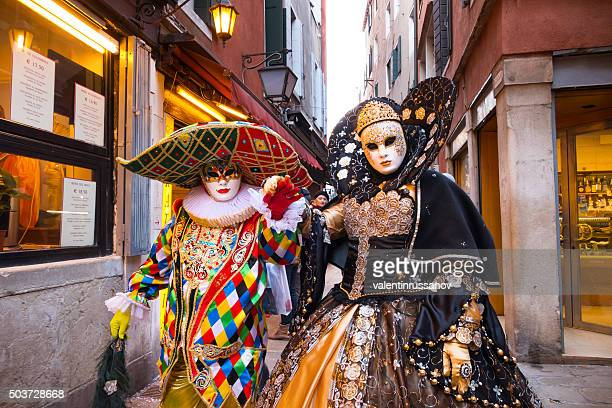 venetian couple during the festival - venice carnival stock pictures, royalty-free photos & images