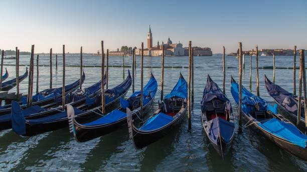 Venetian gondolas, in the back monastery island San Giorgio Maggiore, Venice, Italy