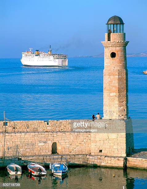 Venetian lighthouse and the ferry to Piraeus Rethymnon Crete Greece Much of the town of Rethymnon was built by the Venetians who ruled Crete from...
