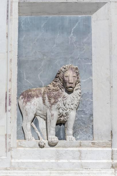 Venetian Lion, relief on the facade of the Scuola Grande di San Marco, Venice, Veneto, Italy
