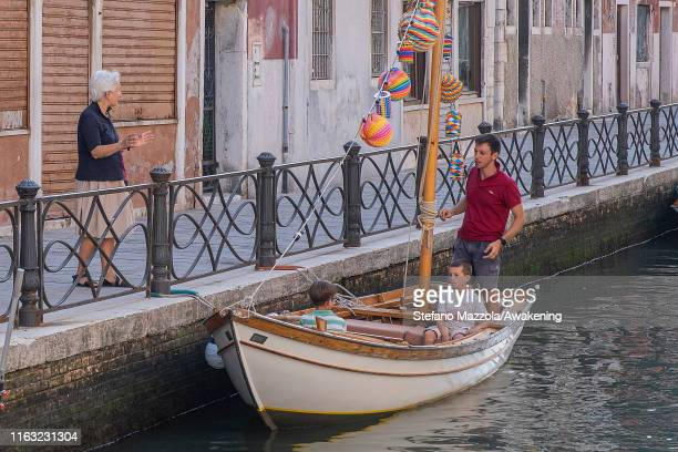 Venetian Man finishes decorating his boat for the Redeemer celebrations on July 20 2019 in Venice Italy Redentore which is in remembrance of the end...