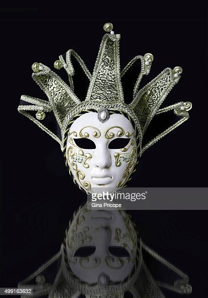 Venetian mask with reflection.