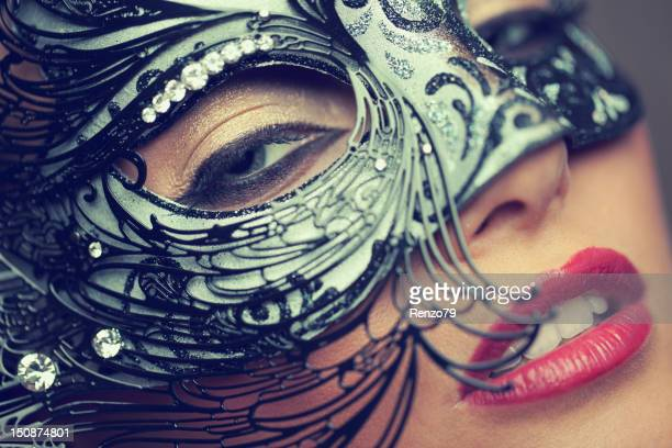 venetian masked blonde - masquerade mask stock photos and pictures