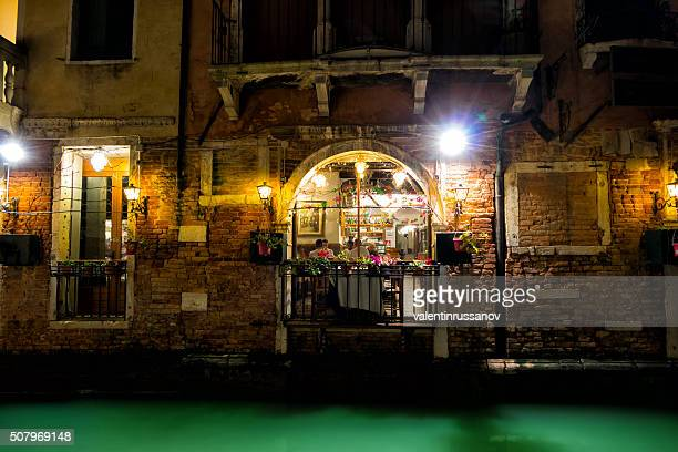 Venetian restaurant by night with lanterns