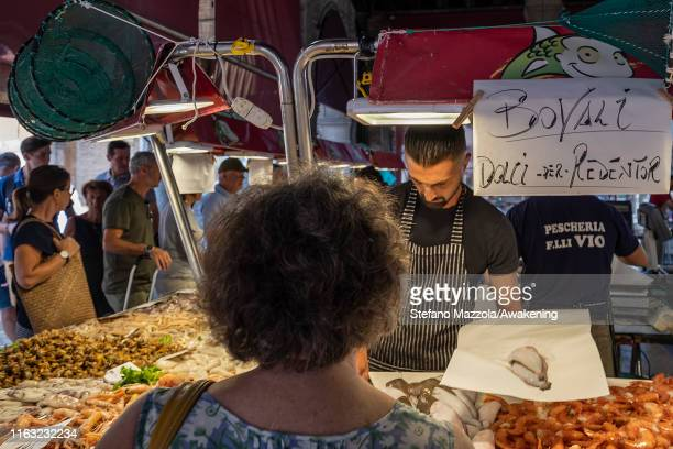 Venetian woman buys sardines for the Redentore dinner on July 20 2019 in Venice Italy Redentore which is in remembrance to the end of the 1577 plague...