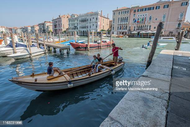 Venetians go by boat to the fish market in Rialto on July 20 2019 in Venice Italy Redentore which is in remembrance of the end of the 1577 plague is...