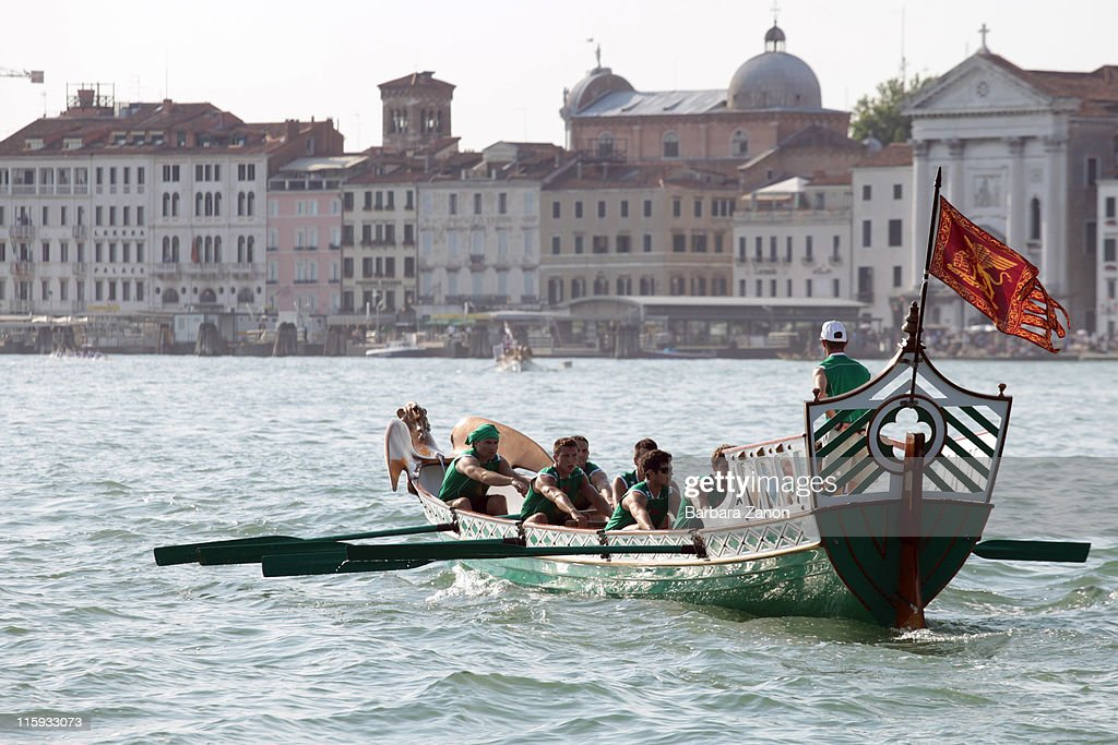 A Venezia team boat sails in front of Riva degli Schiavoni and Saint Mark during the Regatta of Ancient Maritime Republics on June 12, 2011 in Venice, Italy. The Regatta of Ancient Maritime Republics runs every year in one of four places; Venice, Pisa, Amalfi and Genova.