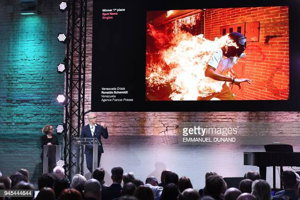 TOPSHOT Venezualan AFP photographer Ronaldo Schemidt speaks in front of his picture taken on May 3 2017 of a demonstrator catching fire during...