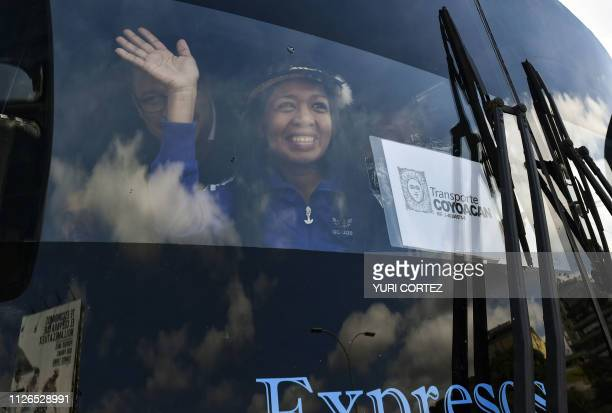 A Venezualan opposition deputy waves while traveling in a caravan of buses heading to the border with Colombia to bring in USsupplied humanitarian...