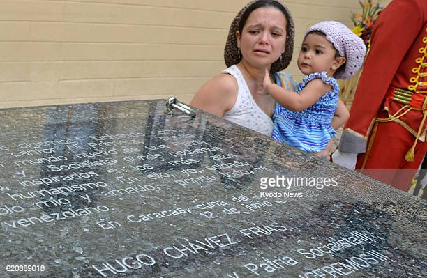 CARACAS Venezuela A woman sheds tears beside the stone tomb of former Venezuelan President Hugo Chavez on display at a military facility in Caracas...