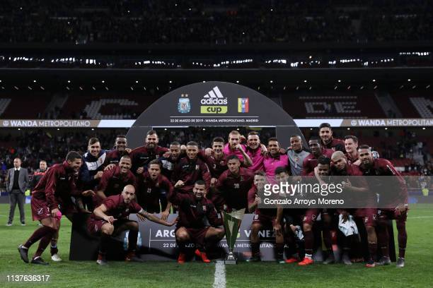 Venezuela celebrate with the trophy afett they win the International Friendly match between Argentina and Venezuela at Estadio Wanda Metropolitano on...