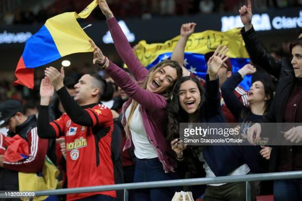 Venezuela fans celebrate during the international friendly match between Argentina and Venezuela at Estadio Wanda Metropolitano on March 22 2019 in...