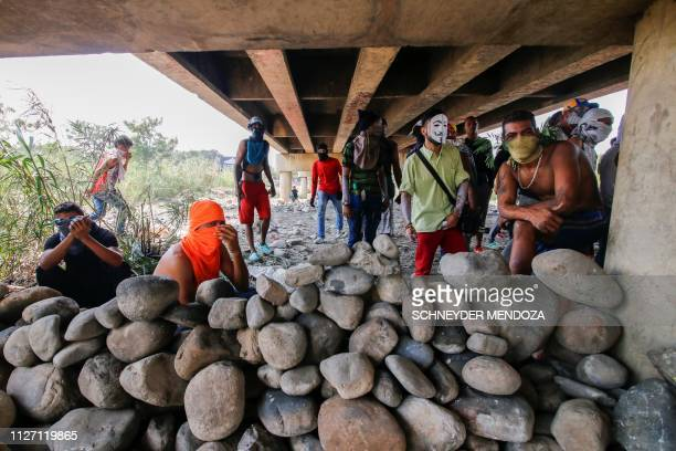 Venezuela opposition demonstrators remain behind a stone barricade under the Simon Bolivar international bridge in Cucuta Colombia on the border with...