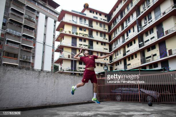 Venezuela player Jose Chema Carrasco makes a jump serve as training in isolation during the radical quarantine to stop the Coronavirus pandemic on...
