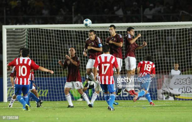 Venezuela players jumps for the block a goal of Paraguay during their match as part of FIFA 2010 World Cup Qualifier at the Cachamay Stadium on...